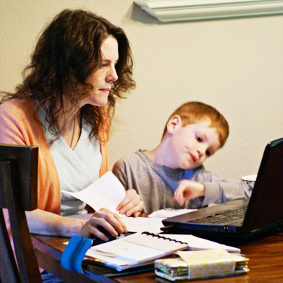Melissa's son helping her work on the budget!