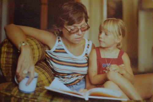 Author Caroline Starr Rose reading with her mother as a child.  Hear hear story and learn how to become a published author on the Brilliant Business Moms Podcast