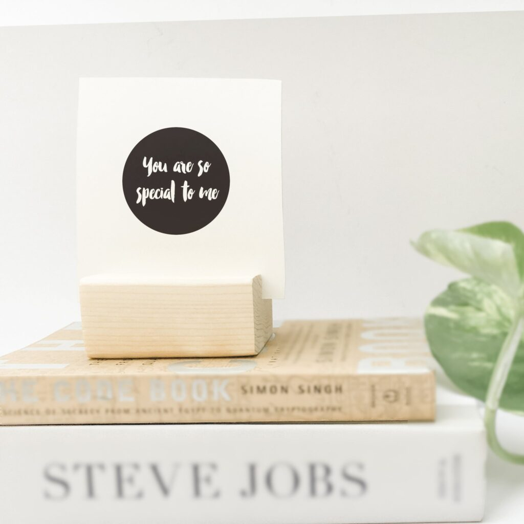 small wooden block on top of book stack holding card that says You are so special to me