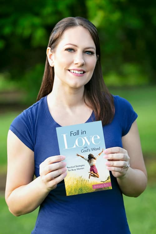 Author Brittany Ann wearing blue shirt, holding her book, Fall in Love with God's Word